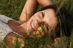Girl resting in meadow Stock Photo