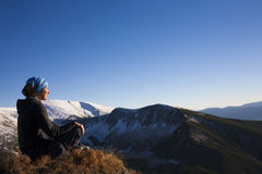 Girl resting in the mountains. Royalty Free Stock Images