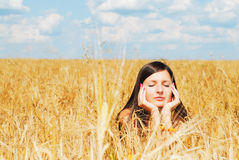 Girl resting on nature. Girl resting on wheat field Royalty Free Stock Image