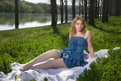 Girl resting on the nature. Royalty Free Stock Image