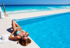 Girl resting near swimming pool in summer Royalty Free Stock Image