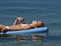 Girl resting on the sea Royalty Free Stock Photography