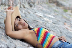 Girl resting on stones Royalty Free Stock Images
