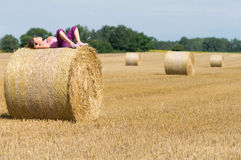 Girl resting on straw Stock Photography
