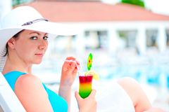 Girl is  resting on a sun lounger with a cocktail Royalty Free Stock Photo