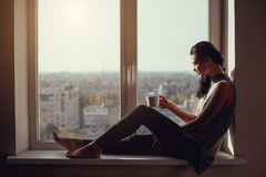 Girl resting and thinking at home Royalty Free Stock Photo