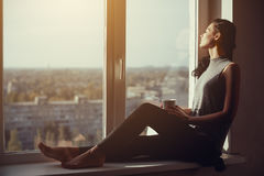 Girl resting and thinking at home Royalty Free Stock Image