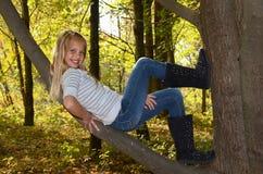 Girl resting in tree Stock Image
