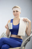 Girl is resting after workout. Stock Photo