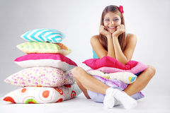 Girl restion on pillows Royalty Free Stock Image