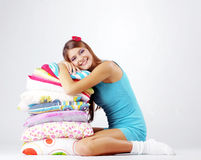 Girl restion on pillows Stock Photos