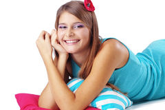 Girl restion on pillows Royalty Free Stock Photos