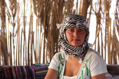 Girl rests in Bedouin tent Stock Photography