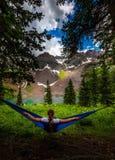 Girl rests on a Hammock looks at Dallas Peak near Lower Blue Lak royalty free stock image
