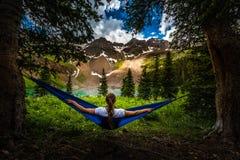 Girl rests on a Hammock looks at Dallas Peak near Lower Blue Lak royalty free stock photo