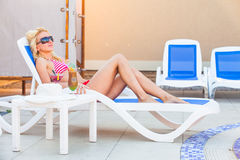 Girl rests near the swimming pool Royalty Free Stock Photography
