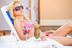 Girl rests near the swimming pool Stock Image