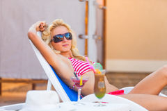 Girl rests near the swimming pool Stock Images