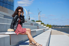 Girl rests on the river in the city.  Stock Photography