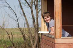 Girl rests in summer house Royalty Free Stock Photos