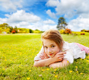 Girl rests in sunny meadow Royalty Free Stock Photo