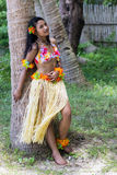 Girl rests on a tree. Hula Hawaii dancer leaning against a palm tree Stock Photography