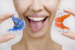 Girl with Retainer for Teeth sticking her Tongue out, Close-up Royalty Free Stock Photo