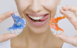 Girl with Retainer for Teeth sticking her Tongue out, Close-up Royalty Free Stock Image