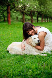 Girl and retriever in park Royalty Free Stock Photography