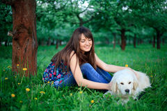 Girl and retriever in park Stock Photos
