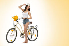 Girl with retro bike Royalty Free Stock Image