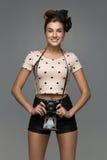 Girl with retro camera Stock Photo