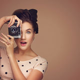 Girl with retro camera Stock Photos