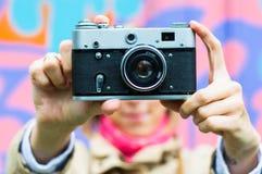 Girl with retro camera Stock Photography