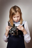 Girl with retro camera Stock Photos
