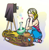 Girl and retro camera. Woman in trousers sits at a table in the form of a dragon next to a camera on a tripod Stock Photography