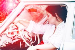 Girl in a retro car. Portrait of beautiful girl in a retro car in style pin up stock image
