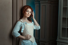 Girl in retro dress flirts looks. royalty free stock photo