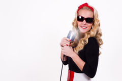 Girl with retro microphone Stock Image