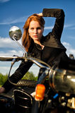 Girl on retro motorbike Stock Photos