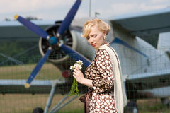 Girl in retro style on background of plane stock photo
