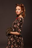 Girl in retro style posing with fur things. Royalty Free Stock Images