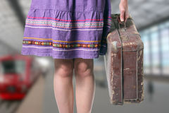 Girl with a retro suitcase at the train station Royalty Free Stock Photography