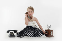 Girl with  retro telephones Royalty Free Stock Photography
