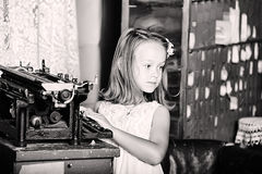 Girl with a retro typewriter Royalty Free Stock Images