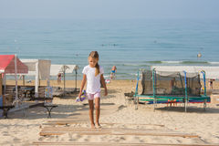 The girl returned to the sea holding hands slapping Royalty Free Stock Photo