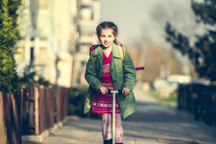 Girl returning from school Stock Photography