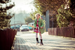 Girl returning from school Royalty Free Stock Images
