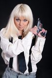 Girl with a revolver Royalty Free Stock Image