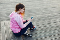 Girl rewritten with her smartphone Stock Photos